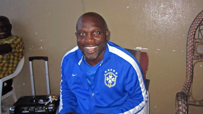 In this photo taken on Sunday, Aug. 10, 2014, Liberian soccer star George Weah smiles inside a room in the city of Monrovia, Liberia. Liberia's world famous soccer star George Weah has produced a song to raise awareness about Ebola, the deadly disease ravaging West Africa. Weah, who before he retired was FIFA's player of the year, is now a politician and singer.(AP Photo/Jonathan Paye-Layleh)