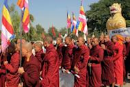 """Myanmar Buddhist monks protest over injuries sustained by clerics in a police crackdown on a rally at a Chinese-backed copper mine, in the northern city of Mandalay on December 12, 2012. Myanmar police used phosphorus in a crackdown on a rally against a copper mine last year, causing """"unnecessary"""" injuries to dozens of protesters, a parliamentary report led by Aung San Suu Kyi said Tuesday"""