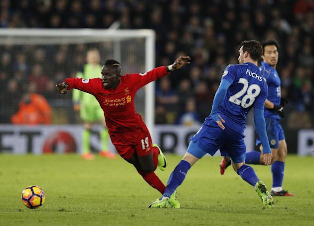Leicester City defender Christian Fuchs (R) tackles Liverpool forward Sadio Mane during the English Premier League match at King Power Stadium in Leicester, central England on February 27, 2017