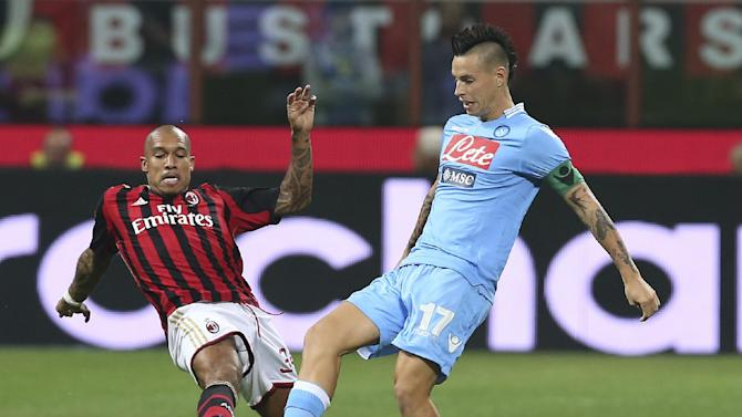 AC Milan midfielder Nigel de Jong, left, of the Netherlands, challenges Napoli midfielder Marek Hamsik, of Slovakia, during the Serie A soccer match between AC Milan and Napoli at the San Siro stadium in Milan, Italy, Sunday, Sept. 22, 2013