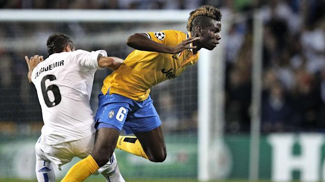 Juventus player Paul Pogba of France, right, and FC Copenhagen's Claudemir de Souza of Brazil,  compete for the ball during their Champions League Group B soccer match at the Parken Stadium, Copenhagen, Denmark, Tuesday Sept. 17, 2013