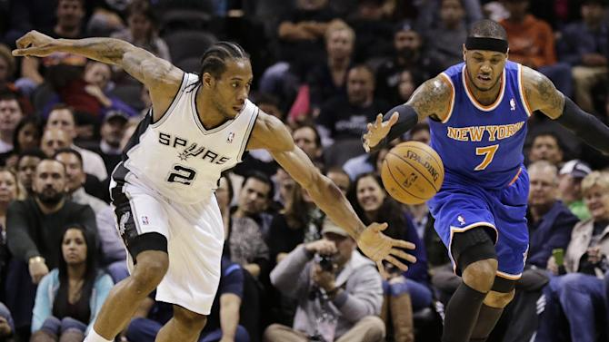San Antonio Spurs' Kawhi Leonard (2) and New York Knicks' Carmelo Anthony (7) chase a loose ball during the first half on an NBA basketball game, Thursday, Jan. 2, 2014, in San Antonio
