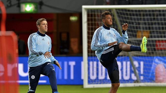 Germany's Max Kruse, left and Jerome Boateng, during training at Friends Arena in Stockholm, Sweden, Monday, Oct. 14, 2013. Germany will play Sweden in the Group C World Cup qualifier match on Tuesday.  (AP Photo /TT News Agency,  Jonas Ekstromer )