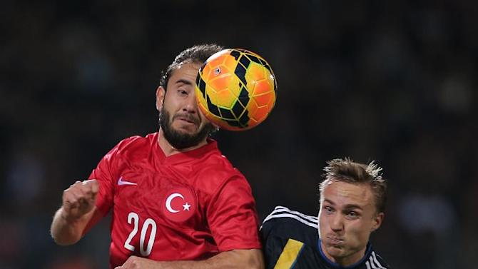 Turkey's Olcan Adin, left, vies with Sweden's Pierre Bengtsson during their International Friendly soccer match at 19 Mayis Stadium in Ankara, Turkey, Wednesday, March 5, 2014.(AP Photo)