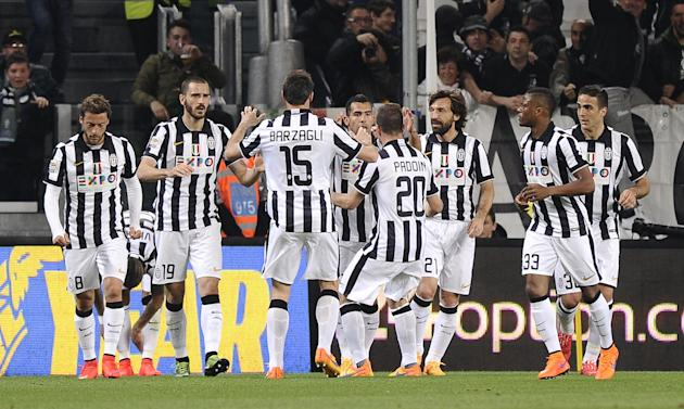 Juventus' Carlos Tevez celebrates with his team mates after scoring against Lazio during their Italian Serie A soccer match in Turin