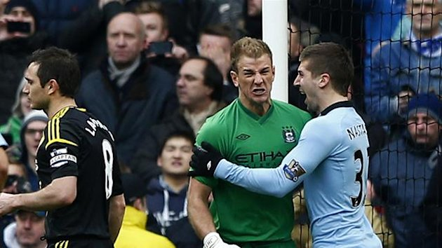 Manchester City's Joe Hart (2nd R) reacts to saving a penalty from Chelsea's Frank Lampard (C) during their English Premier League soccer match at The Etihad Stadium in Manchester, northern England, February 24, 2013 (Reuters)