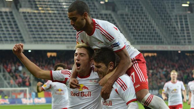 Salzburg's Kevin Kampl, left, Alan, top,   and Jonatan Soriano celebrate after scoring  during the Europa League group C soccer match  between Red  Bull Salzburg and Standard Liege  in Salzburg, Austria, Thursday, Oct.  24, 2013
