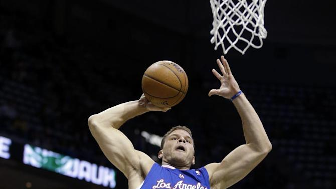 Los Angeles Clippers (32) Blake Griffin dunks against Milwaukee Bucks' Brandon Knight, back, during the first half of an NBA basketball game, Monday, Jan. 27, 2014, in Milwaukee