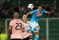 Serie A side Napoli have tied Edinson Cavani (right), seen here in August 2012, to an improved deal that will not expire until 2017 but used the occasion to take a cheeky swipe at English champions Manchester City