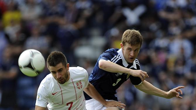 Paul Dixon, right, put in a man-of-the-match performance against Serbia