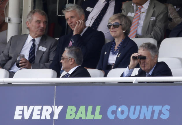 Prime Minister Theresa May watches over the action