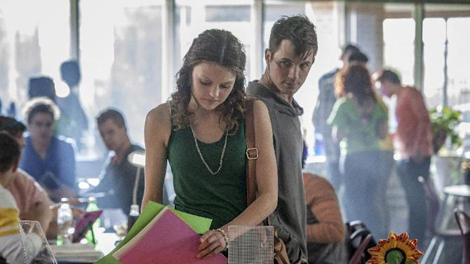 """This publicity image released by The CW shows Aimee Teegarden as Emery, center, and Matt Lanter as Roman in the pilot episode of the new series """"Starcrossed,"""" airing this fall on the CW. (AP Photo/The CW, Skip Bolen)"""