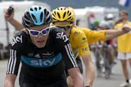 Britain's Christopher Froome during stage 17 of the Tour de France on July 19. With a 2min 05sec lead on Sky teammate Froome and 2:41 on Italian Vincenzo Nibali, Bradley Wiggins, barring catastrophe, will become Britain's first yellow jersey champion on Sunday
