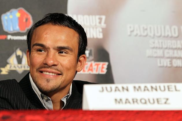 BEVERLY HILLS, CA - SEPTEMBER 17: Boxer Juan Manuel Marquez smiles during the Manny Pacquiao v Juan Manuel Marquez - Press Conference at Beverly Hills Hotel on September 17, 2012 in Beverly Hills, California. (Photo by Victor Decolongon/Getty Images)