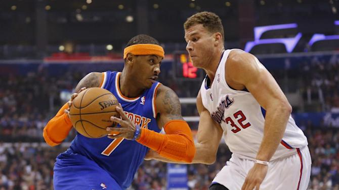 New York Knicks' Carmelo Anthony, left, drives with the ball as Los Angeles Clippers' Blake Griffin, right, defends, during the first half of an NBA basketball game in Los Angeles, Wednesday, Nov. 27, 2013