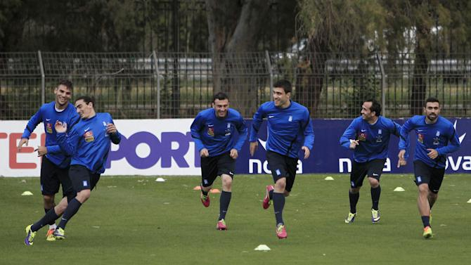 Greek national soccer team players run during a training session in Athens, Thursday, Nov. 14, 2013. The Greek national soccer team will face Romania for a World Cup qualifying playoff on Friday