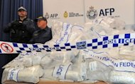 Australian Federal Police guard US$525 million worth of crystal methamphetamine and heroin after smashing a Hong Kong-based international drugs syndicate in Sydney on July 31. It was the largest haul of icein Australian history and the third-biggest heroin bust