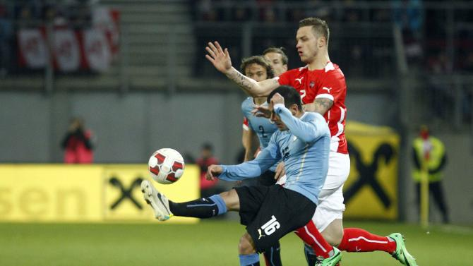 Austria's Arnautovic and Uruguay's Peireira fight for the ball during their international friendly soccer match in Klagenfurt