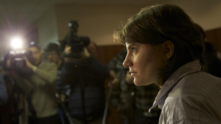 Member of the Pussy Riot punk band Yekaterina Samutsevich speaks to press after a court hearing, in Moscow, Russia, Wednesday, Jan. 30, 2013. Samutsevich's efforts to repeal a decision banning the group's videos in Russia was rejected by the court. (AP Photo/Ivan Sekretarev)