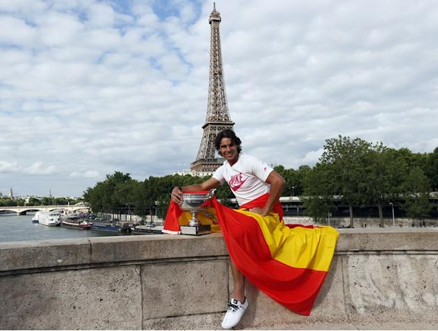 TOPSHOTS Spanish Tennis Player Rafael Nadal  Poses With His Trophy And The Spanish Flag In Front Of The Eiffel Tower On  AFP/Getty Images