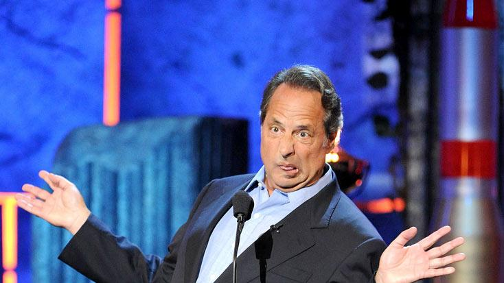 Comedian Jon Lovitz speaks onstage at Comedy Central's Roast of Charlie Sheen.