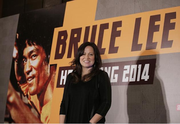"HOLD FOR STORY - FILE - In this Nov. 24, 2014 file photo, Shannon Lee, daughter of Bruce Lee and president of the ""Bruce Lee Foundation,"" poses for photographers during a press conference la"
