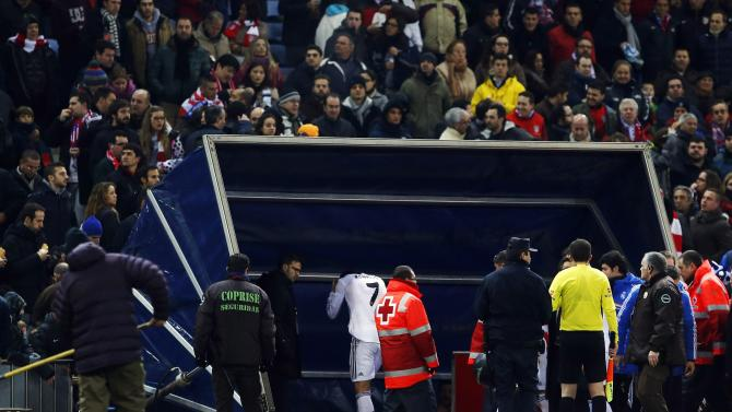 Real Madrid's Ronaldo grabs his head after being hit with a lighter at the end of the first half of their Spanish King's Cup semi-final second leg soccer match against Atletico Madrid in Madrid