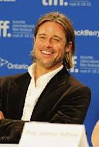 Brad Pitt smiles while speaking at the 'Moneyball' Press Conference during 2011 Toronto International Film Festival in Toronto, Canada, on September 9, 2011 -- Getty Images