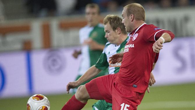 Thun's Marco Schneuwly, right, challenges  for the ball  with  Vienna's Mario Sonnleitner, left, during the UEFA Europa League  group G soccer match between Switzerland's FC Thun and Austria's SK Rapid Vienna at the Arena stadium in Thun, Switzerland, Thursday, Sept. 19, 2013