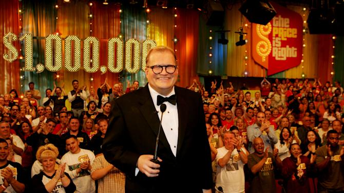 "HOLD FOR LYNN ELBER STORY/PERMISSION - FILE - In this February 2008 publicity image released by CBS Entertainment, host Drew Carey hosts pauses during a taping of of ""The Price is Right Million Dollar Spectacular,"" one of six new specials to be broadcast on Fridays, beginning Feb. 22, 2008,  on the CBS Television Network. A Los Angeles jury says a former model on ""The Price is Right"" was discriminated against by producers because of her pregnancy. The Superior Court jury awarded nearly $777,000 to Brandi Cochran on Tuesday, Nov. 20, 2012. (AP Photo/CBS, Monty Brinton, File) ** MANDATORY CREDIT. NO ARCHIVE. NO SALES. NORTH AMERICA USE ONLY. **"