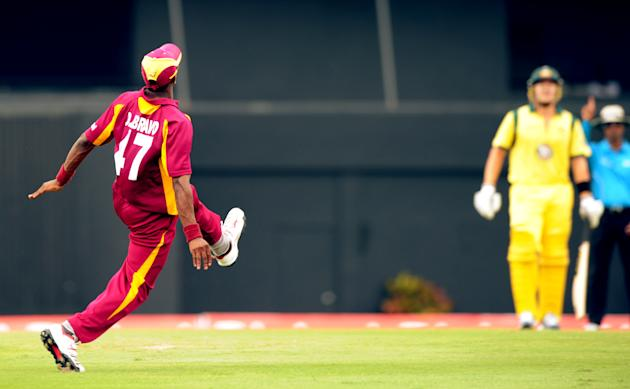 West Indies cricketer Dwayne Bravo (L) c
