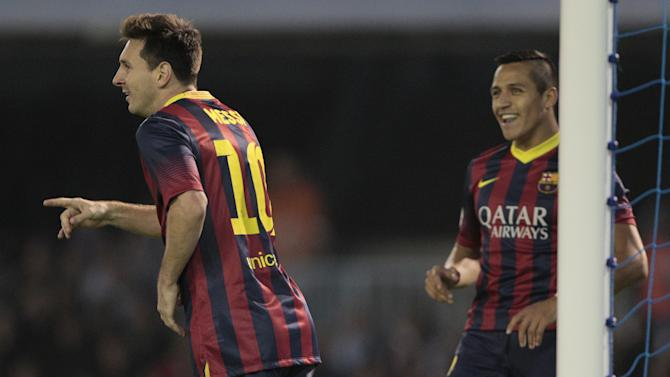 FC Barcelona's  Lionel Messi, left,  from Argentina and Alexis Sanchez from Chile, react, during a Spanish La Liga soccer match between Barcelona and RC Celta at the Balaidos stadium in Vigo, Spain, Tuesday, Oct. 29, 2013