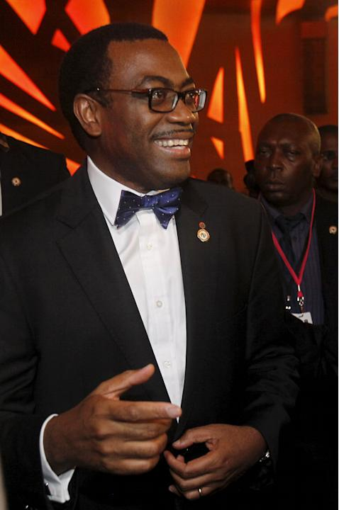 Nigeria's Agriculture Minister Akinwumi Adesina laughs during the annual meeting commemorating the 50th anniversary of the African Development Bank (AfDB) in Abidjan
