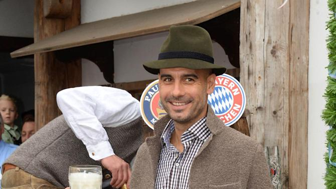 Bayern Munich's head coach Pep Guardiola poses as he attends the Oktoberfest beer festival in Munich southern Germany, Sunday, Oct 6, 2013