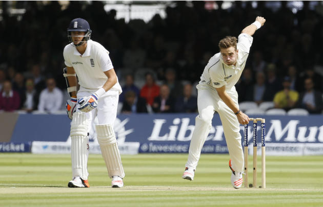New Zealand's Tim Southee, right, bowls to England's Moeen Ali , watched by England's Stuart Broad during the second day of the first Test match at Lord's cricket ground in London, Fri