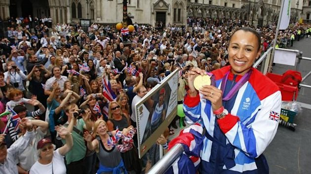 Heptathlete Jessica Ennis holds her gold medal during a parade as it passes the High Court in the City of London September 10, 2012 (Reuters)