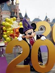 Mickey poses during the launch of Disneyland Paris' 20th birthday celebrations in Chessy, outside Paris in March 2012. Last year, the park provided about 55,000 direct and indirect jobs
