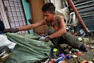 Myanmar ethnic Rohingya refugee Mohd Alam sorts out metal items to recycle in the suburbs of Kuala Lumpur. Myanmar's neighbours should prepare to accept refugees from the country's Rohingya minority who may try to flee abroad to escape bloody communal violence, refugee organisations say