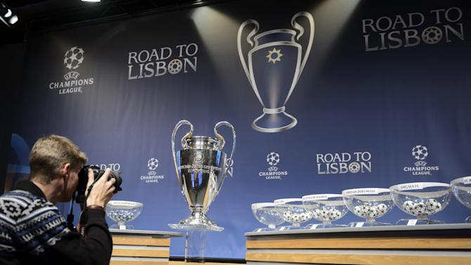 A photographer takes picture during the draw of the round of 16 games of UEFA Champions League 2013/14 at the UEFA Headquarters in Nyon, Switzerland, Monday, Dec. 16, 2013