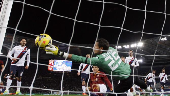 Cagliari's goalkeeper Avramov makes a save against AS Roma's Burdisso during their Italian Serie A soccer match at the Olympic stadium in Rome