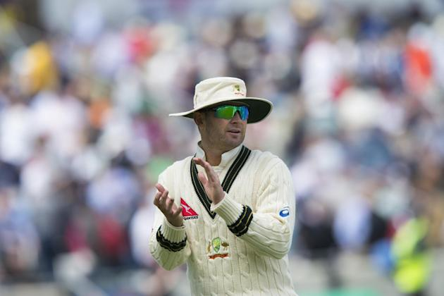 Australia's captain Michael Clarke applauds his players from the pitch at lunch on the second day of the third Test match of the five match series between England and Australia at Edgbaston cricke