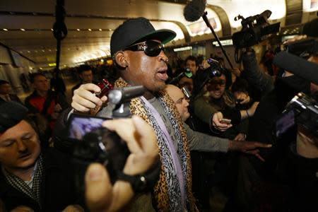 Former NBA basketball player Rodman speaks to the media at Beijing airport