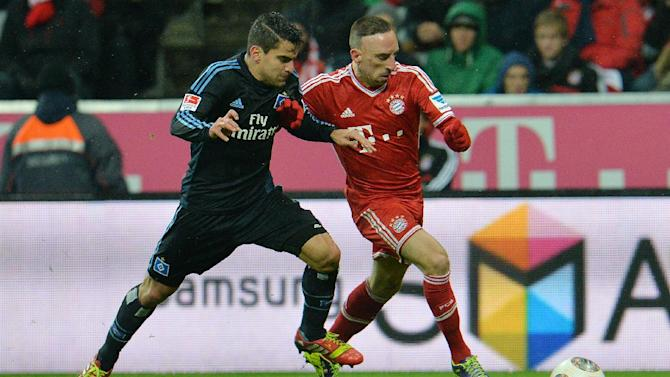 Bayern's Franck Ribery of France, right, and Hamburg's Hernandez Rincon challenge for the ball   during  the German first division Bundesliga soccer match between FC Bayern Munich and Hamburger SV  in Munich, Germany, Saturday, Dec. 14, 2013