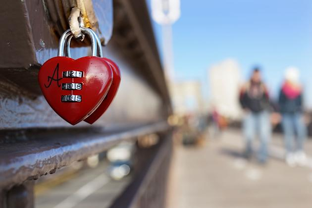 Couples Symbolize Their Love By Attaching Locks To The Brooklyn Bridge