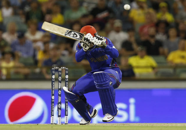 Afghanistan's Usman Ghani ducks to avoid a bouncer during their Cricket World Cup Pool A match against Australia in Perth, Australia, Wednesday, March 4, 2015. (AP Photo Theron Kirkman)
