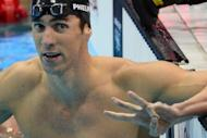 """US swimmer Michael Phelps gestures """"three"""" with his fingers after winning gold in the men's 200m individual medley final at the London 2012 Olympic Games on August 2 -- a historic third consecutive win"""