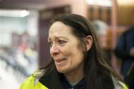 Tina Shay (L) reacts after hearing that a union vote narrowly passed by 51% in support of Boeing's contract with the International Association of Machinists and Aerospace Workers (IAM) District Lodge 751 to construct the wings for the 777X jetliner in Seattle, Washington January 3, 2014. REUTERS/David Ryder