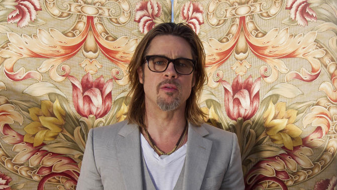 In this photo taken Wednesday, May 23, 2012. Brad Pitt poses for portraits for the film Killing Them Softly, during the 65th Film Festival in Cannes, France. (AP Photo/Joel Ryan)