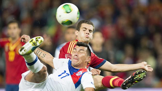"Spain's Jose Ignacio Fernandez ""Nacho"", back, challenges for the ball with Chile's  Gary Medel, front, during a friendly soccer match between Spain and Chile at the Stade de Geneve stadium, in Geneva, Switzerland, Tuesday, Sept. 10, 2013"