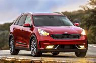 This image provided by Kia shows the 2017 Kia Niro. Kia's newest vehicle, the 2017 Niro, is the lowest-priced, gasoline-electric hybrid SUV on the market and is rated as high as 50 miles per gallon in combined city/highway travel. (Greg Jarem/Kia via AP)